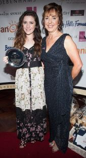 Orlaith Carmody presenting Melanie Murphy with the 2015 Irish Beauty Blog Award for Best Vlogger Blog sponsored by TanOrganic. The event was held at Lillies Bordello, Dublin. Pic Patrick O'Leary NO REPRO FEE